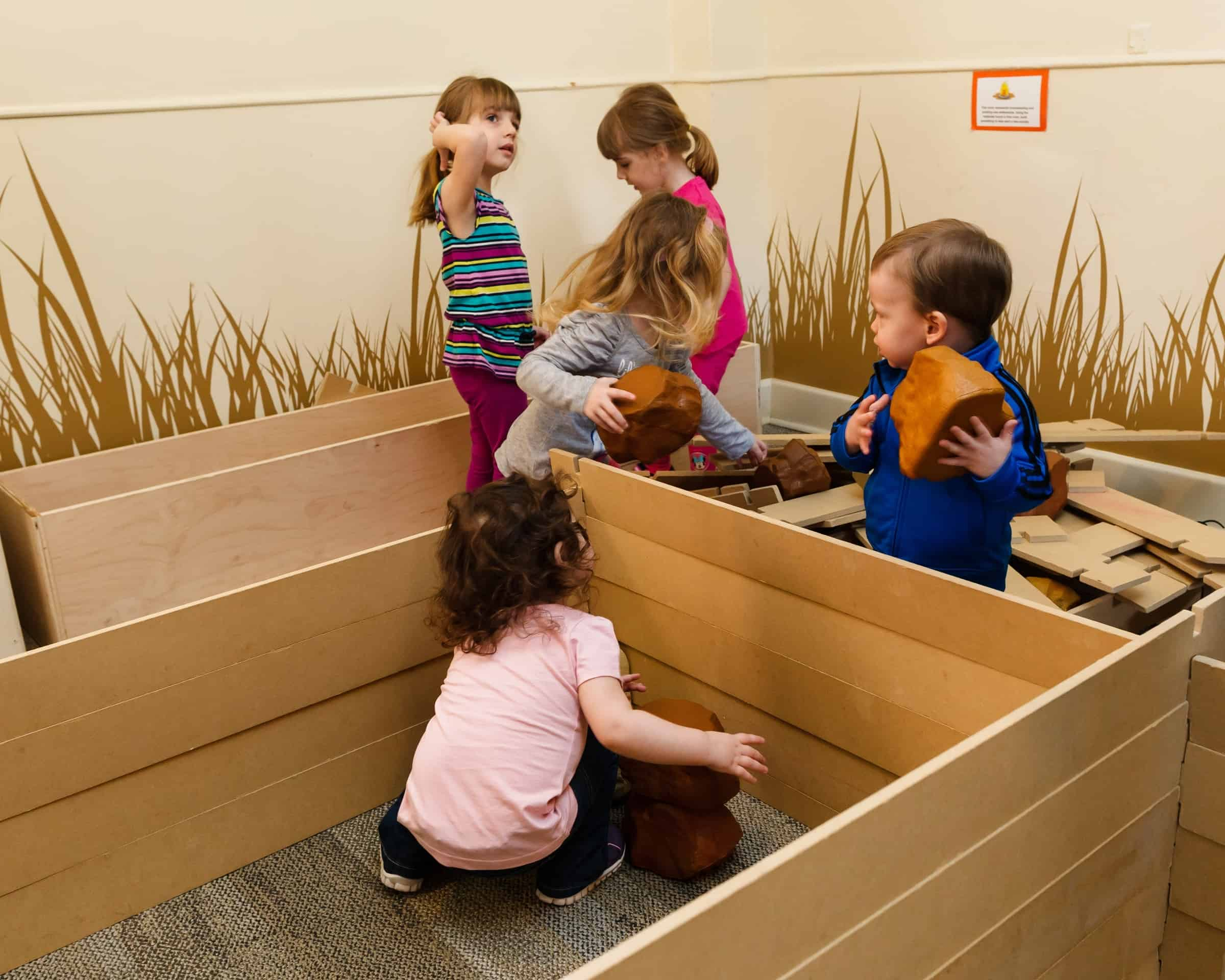 Children playing with museum toys