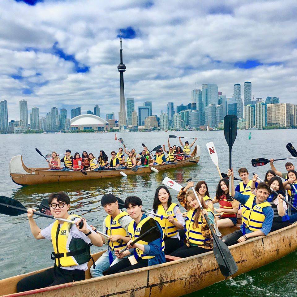 paddle toronto islands in big voyageur canoe